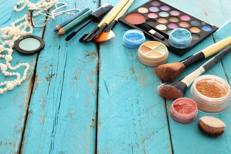 Image of makeup cosmetics beauty tools and brushes on wooden background