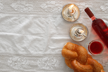 shabbat image. challah bread, wine and candles. Top view. Stock Photo
