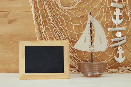 photo album: Nautical concept with sea life style objects on wooden table. Top view.