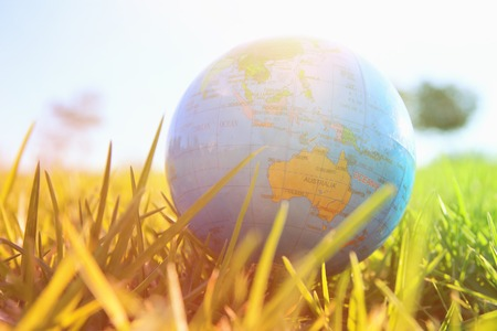 low angle small globe in the grass. travel and global issues concept.