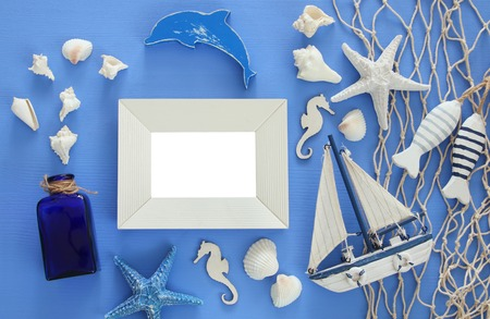 photo album: Top view of Nautical concept with sea life style objects on wooden table. For photography montage.