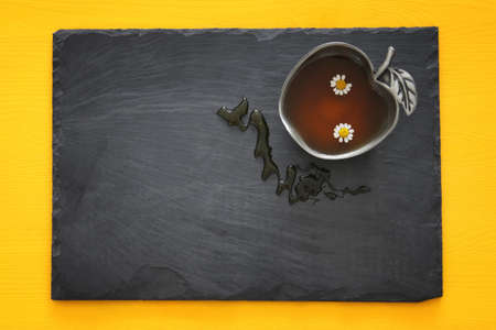 Honey on slate board. Rosh hashanah (jewish New Year holiday) concept. Traditional symbol