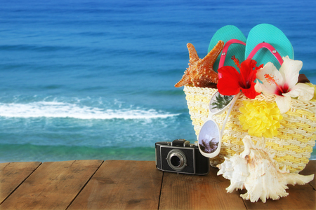 Beach objects on wooden table. Summer beach vacation concept.