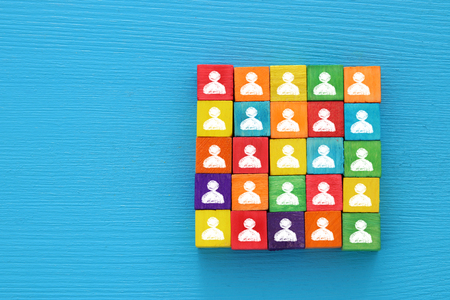 top view image of a wood blocks with people icons , human resources and management concept