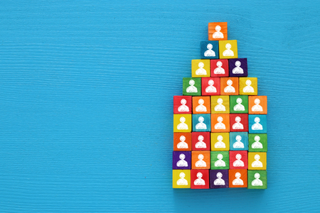 top view image of a wood blocks pyramid with people icons , human resources and management concept Banque d'images
