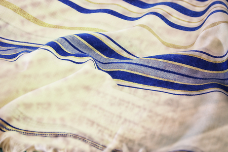 Abstract image of white Prayer Shawl - Tallit, jewish religious symbol. Double exposure concept. Stock Photo
