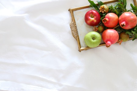 Rosh hashanah (jewesh New Year holiday) concept - pomegranate. Traditional symbol.