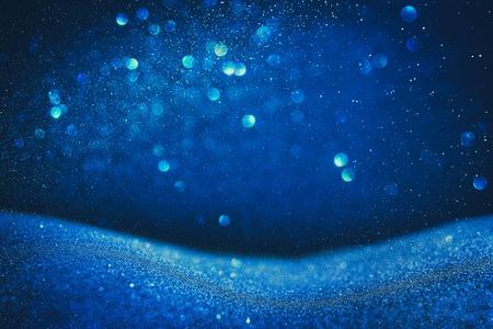 glitter vintage lights background. blue and black. de focused Stock Photo
