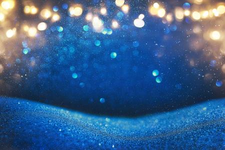 glitter vintage lights background. blue, gold and black. de focused