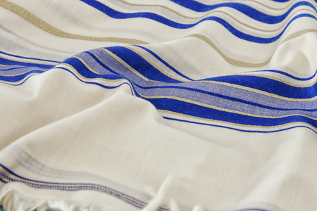 White Prayer Shawl - Tallit, jewish religious symbol. Stock Photo