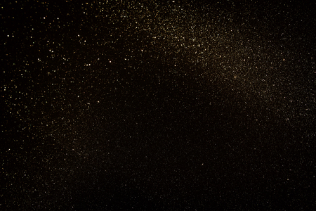 Gold and black glitter vintage lights background. defocused. Stock Photo