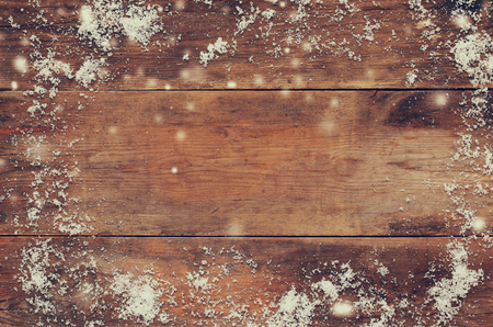 Wooden background covered with snow. Stock Photo