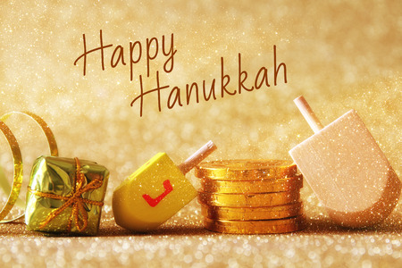 Image of jewish holiday Hanukkah with wooden dreidel (spinning top) on the glitter background Stock Photo