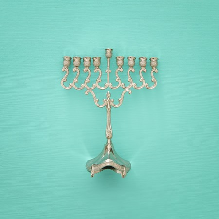 jewish holiday Hanukkah image background with traditional menorah (traditional candelabra). Stock Photo