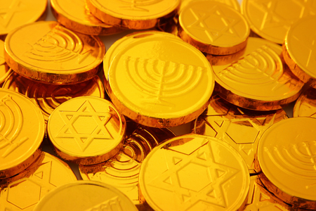 Image of jewish holiday Hanukkah with wooden dreidels colection (spinning top) and gold chocolate coins.