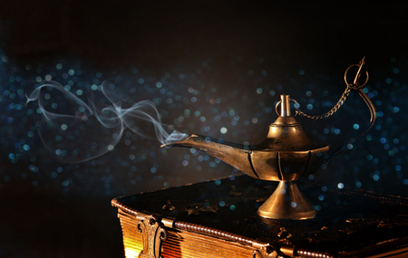 Image of magical magic lamp on old books. Lamp of wishes. Standard-Bild