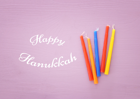 jewish holiday Hanukkah image background with traditional menorah candles. Stock Photo