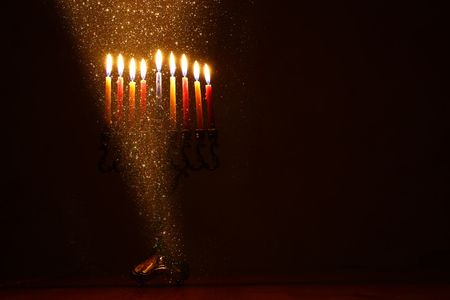 low key image of jewish holiday Hanukkah background with menorah (traditional candelabra) and burning candles Stock Photo