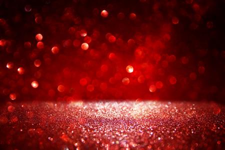metalic texture: Red glitter vintage lights background. defocused