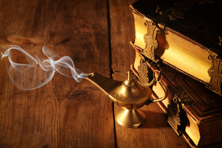Image of magical aladdin lamp with smoke. Lamp of wishes Stock Photo