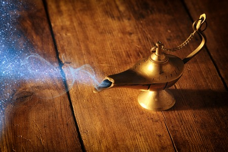 Image of magical aladdin lamp with glitter smoke. Lamp of wishes