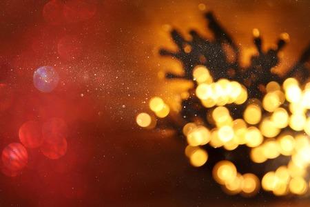 glitter garland lights background. gold and black. de-focused