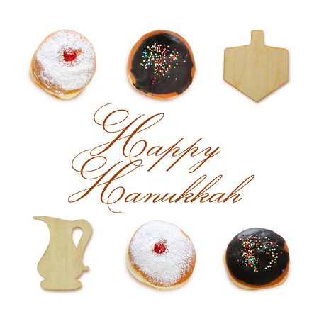 jewish holiday Hanukkah image with traditional doughnuts and spinning to isolated on white.