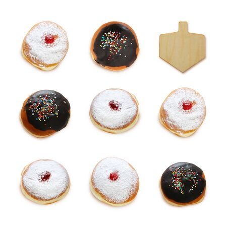 jewish holiday Hanukkah image with traditional doughnuts and spining top isolated on white