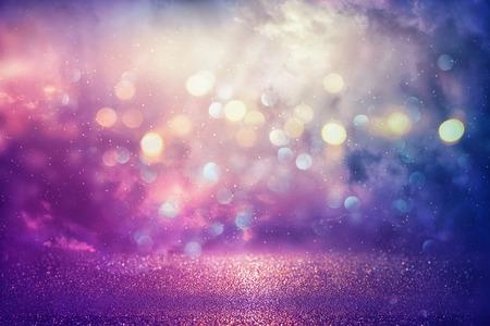 Purple glitter lights background. defocused