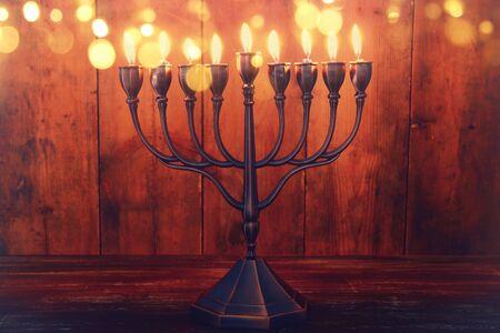 image of jewish holiday Hanukkah background with menorah (traditional candelabra) and burning candles Stock Photo