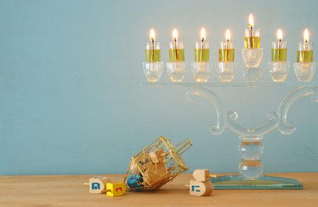 image of jewish holiday Hanukkah background with menorah (traditional candelabra) and burning candles Stockfoto