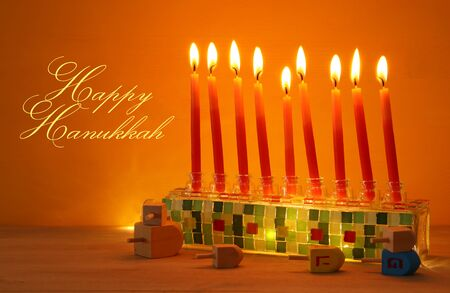 image of jewish holiday Hanukkah background with menorah (traditional candelabra) and candles