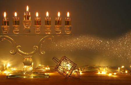image of jewish holiday Hanukkah background with menorah (traditional candelabra) and burning candles Standard-Bild