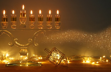 image of jewish holiday Hanukkah background with menorah (traditional candelabra) and burning candles Foto de archivo
