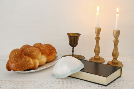 shabbat image. challah bread, shabbat wine and candles on the table Stock Photo