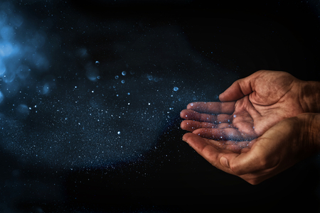 closeup hands of man begging for help. concept for poverty or hunger, seeking for light in the dark Standard-Bild