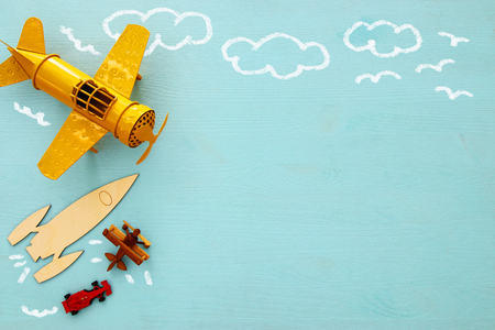 Concept of imagination, creativity, dreaming and childhood. Old toys: car, rocket and plane with info graphics sketch on the blue background