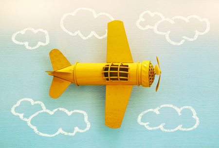 Concept of imagination, creativity, dreaming and childhood. Retro toy plane with info graphics sketch on the blue background Stock Photo