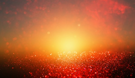 Black, gold and red glitter lights background. Stock Photo