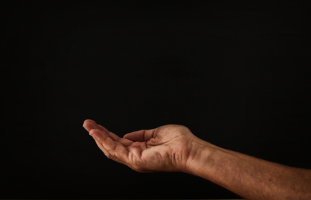image of open male hand begging for help