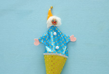 Purim celebration concept (jewish carnival holiday). Top view of clown noise maker toy Stock Photo