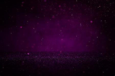 Purple and black glitter lights background. defocused Stock Photo