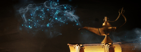 Image of magical aladdin lamp and old books. Lamp of wishes Stock fotó