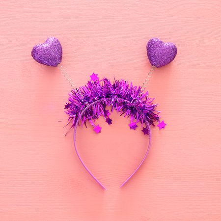 Top view image of funny party head glitter accessory with hearts. Flat lay. Purim celebration concept (jewish carnival holiday)