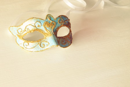 Image of delicate blue elegant venetian mask white background