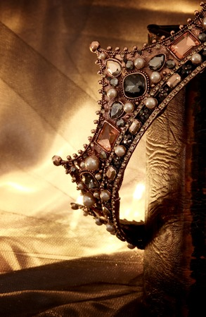 low key image of beautiful queen/king crown on old book. fantasy medieval period Archivio Fotografico