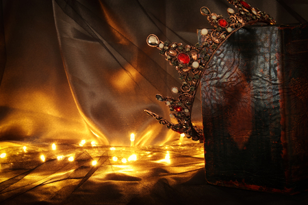 low key image of beautiful queenking crown on old book. fantasy medieval period Stock Photo