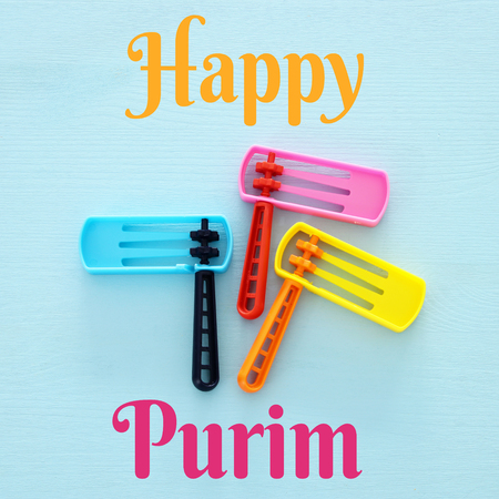 Purim celebration concept (jewish carnival holiday). Top view of noise maker traditional toy
