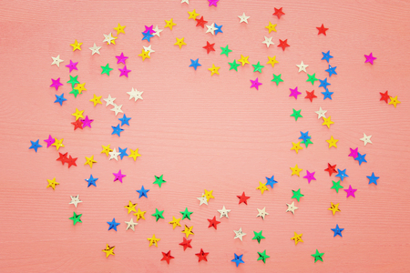 party background with colorful confetti. Top view Stock Photo