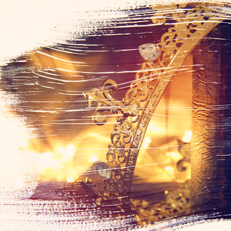 abstract image of of beautiful queenking crown on old book. fantasy medieval period. double exposure effect Stock Photo